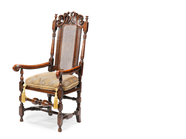 A late 17th century beech stained and simulated-grain cane-back open armchair