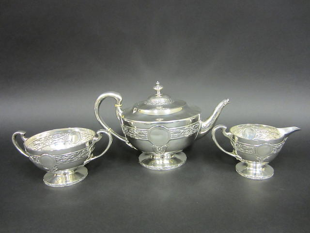 "A silver three piece ""Celtic"" tea service by J.Blond & Sons, Glasgow 1918"