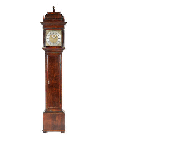 A rare early 18th century walnut longcase clock of one month duration  Daniel Quare, London