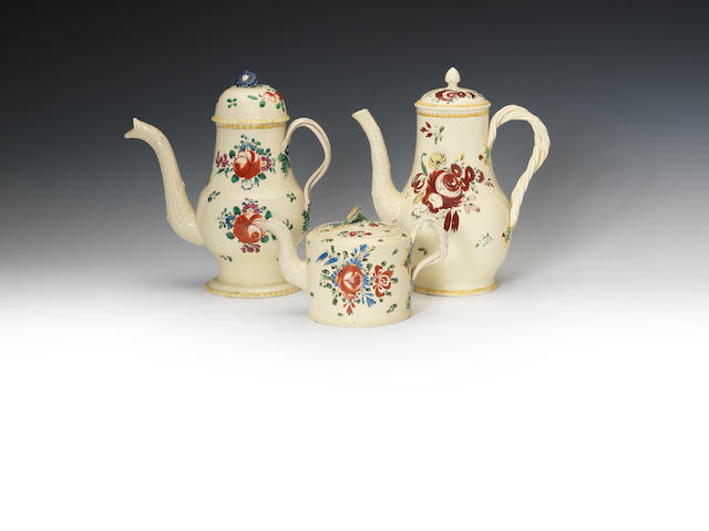 Two creamware coffee pots and covers and a teapot and cover, circa 1780