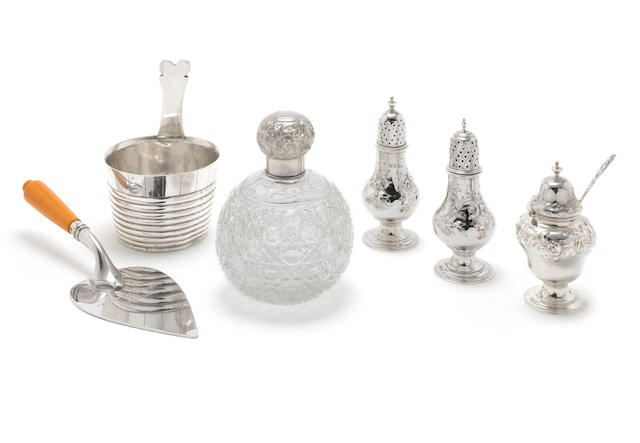 A Victorian  silver cased three-piece cruet set by Edward, John & William Barnard, London, 1850; together with a silver-mounted table scent bottle, a Scottish piggin and a plated presentation trowel,   (7)