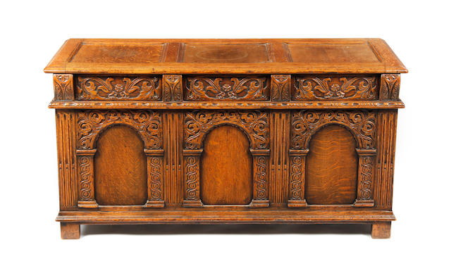 An early 20thC heavily carved oak coffer
