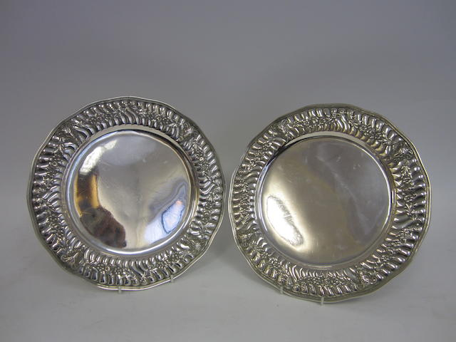 A French silver pair of circular plates 19th century, bearing earlier marks