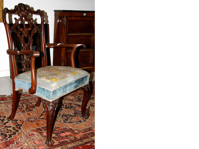 A George III style mahogany ribboned back open armchair,