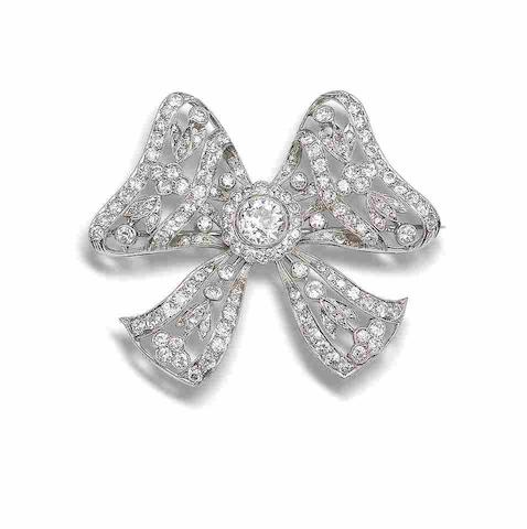 A diamond bow brooch,