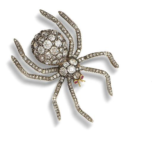 A diamond and ruby spider brooch,