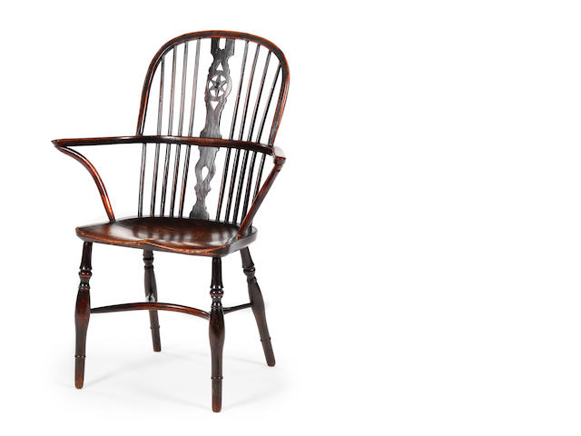 A mid-19th century yew and elm high-back Windsor armchair
