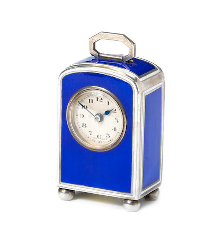 A fine early 20th century silver and enamel decorated miniature travelling timepiece
