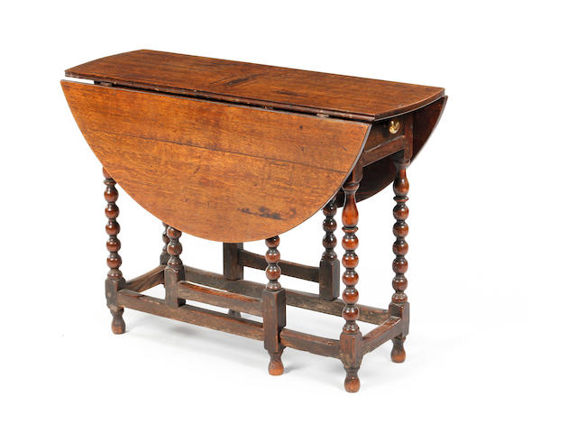 An oak gateleg tableCirca 1700 and later