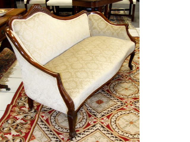 An Edward VII mahogany framed settee and companion open armchir,