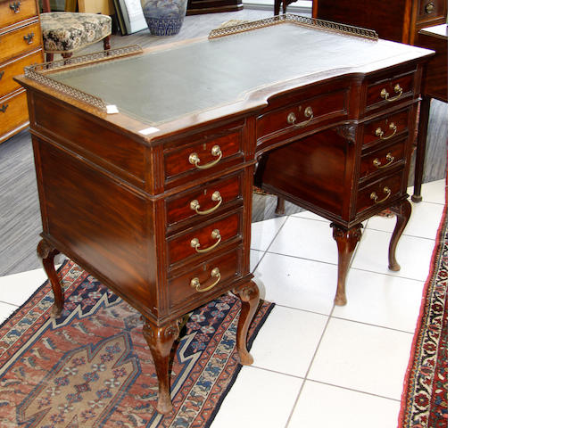 An early 20th Century mahogany kneehole desk,