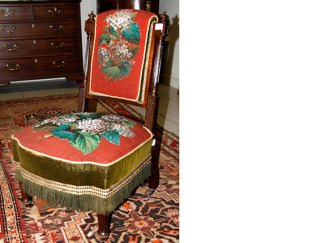 A Victorian walnut low chair,