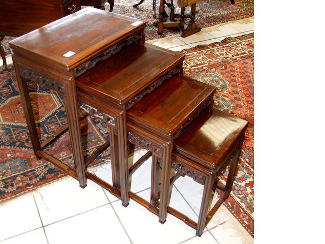 A Chinese nest of four rosewood occasional tables,