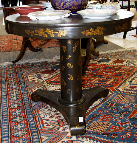 A chinoiserie circular lacquered occasional table,