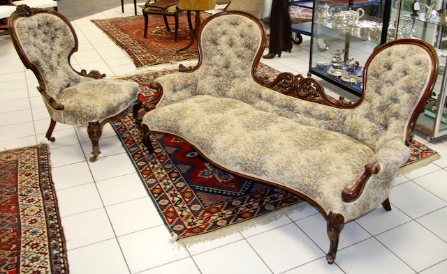 A Victorian mahogany framed butterfly back settee,