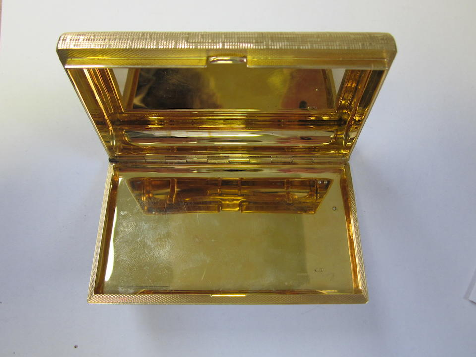An 18 carat gold cigarette box London 1965, also incuse mark 750, engraved Kutchinsky London