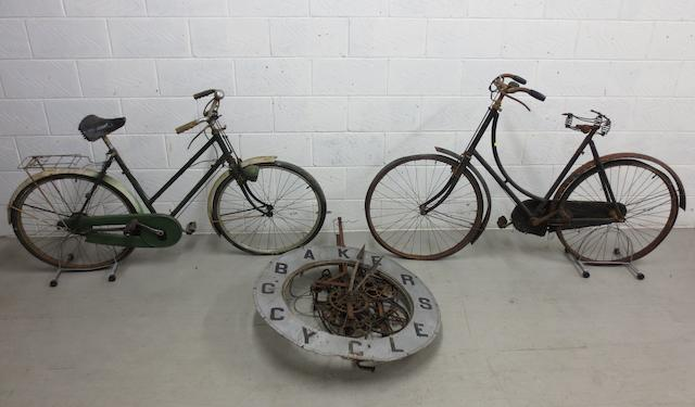 A G.Baker cycles wall mounting advertising clock,