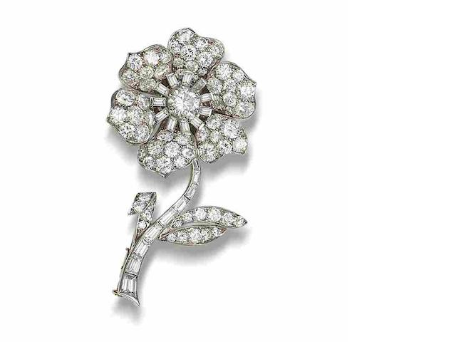 A diamond flower brooch,  by Van Cleef & Arpels,