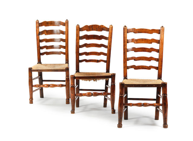 Three 19th century ash wavy ladder-back dining chairs