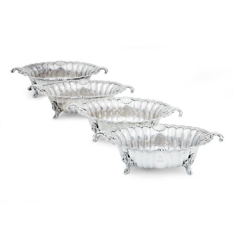 A set of four George III silver sweetmeat dishes with Edinburgh Assay Office marks 2012, original marks spurious, now filled