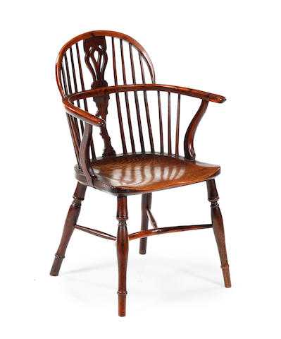A mid-19th century yew, elm and beech low-back Windsor chair