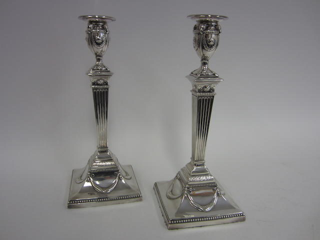 A Victorian pair of silver candlesticks by John Lowe, Chester 1887