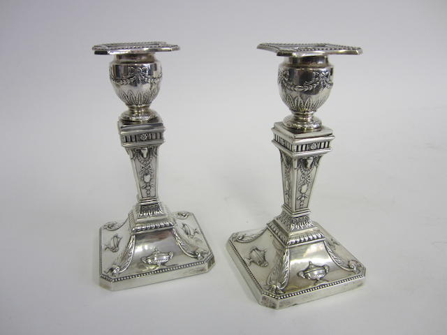 An Edwardian silver pair of candlesticks by Walker & Hall, Sheffield 1904