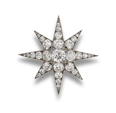 A diamond star brooch,