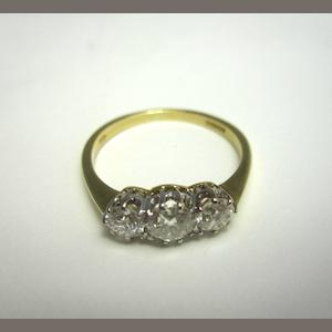 An 18ct gold three-stone diamond ring