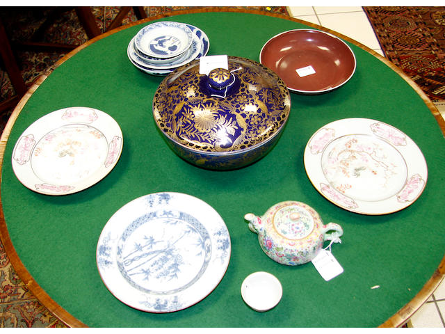 A Qianlong copper red dish,seal mark and of the period, 21cm diameter and a collection of chinese porcelain to include: a small famille rose cup, documentary inscription, Daoguang mark and period, four small saucer dishes, ming and later, a small famille rose enamelled tea pot and cover, 25cm diameter, a pair of plates and another (13)