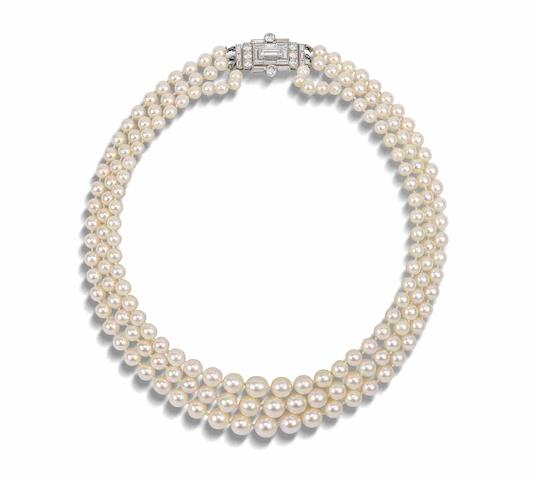 A three-row cultured pearl necklace with art deco diamond clasp
