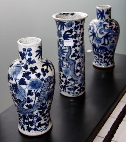 A garniture of three late 19th/early 20th Century Chinese blue and white vases,
