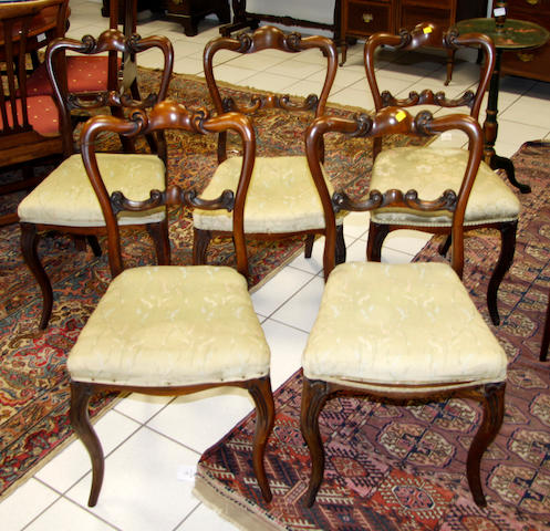 A set of five Victorian rosewood crown back dining chairs,