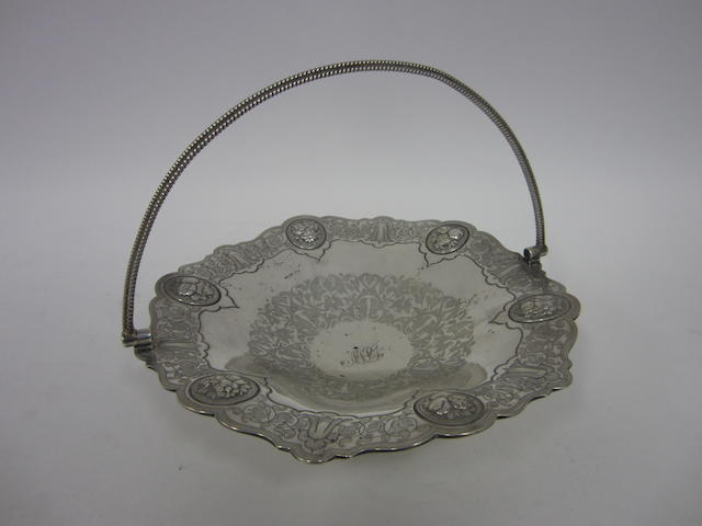 A Victorian silver swing-handle pedestal basket by Thomas Bradbury & Sons, Sheffield 1859