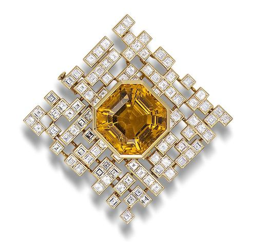 A topaz and diamond brooch