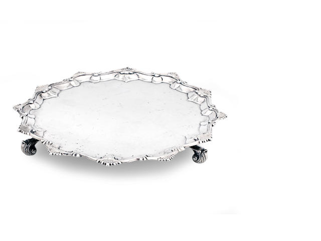 An early George II silver salver  by Ebenezer Coker, London 1766