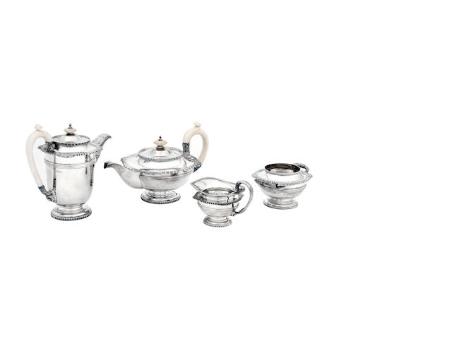 A four piece silver tea service by Walker and Hall, Sheffield 1937