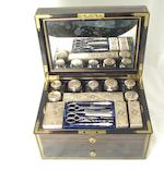 A Victorian coromandel vanity case the silver lids by James Vickery, London 1863/64, the box by T.W. Hopkins of Bond Street London, the lock by Samson Mordan & Co. of London