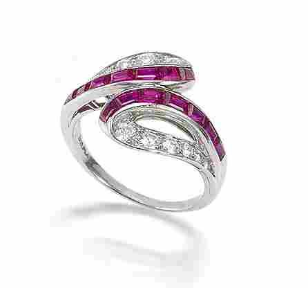 A ruby and diamond crossover ring, by Van Cleef & Arpels,