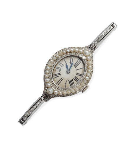 A lady's diamond and half pearl cocktail watch