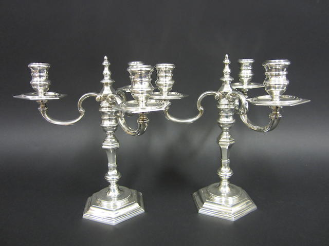 A silver pair of three branch, three light candelabra by Richard Comyns, London 1961