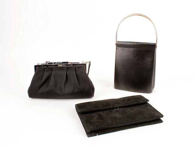 Three Cartier bags - one black ribbed silk, one black suede bag and one black leather