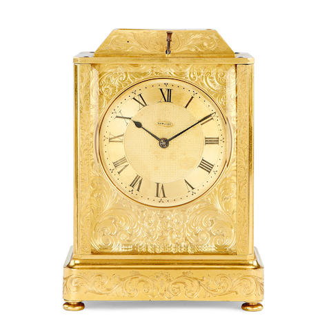 A late 19th century gilt brass carriage clock with repeat