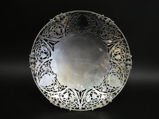 A silver circular pierced shallow fruit bowl by Barker Bros., Sheffield 1965