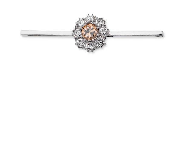 A diamond and coloured diamond brooch