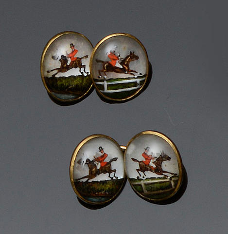 A pair of 18ct gold horse and jockey reverse painted crystal cufflinks