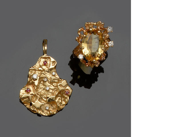 A citrine and diamond dress ring and a ruby and diamond set pendant (2)