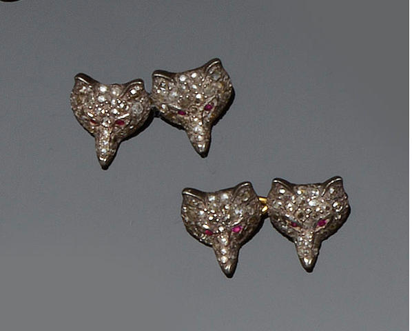 A pair of fox mask cufflinks