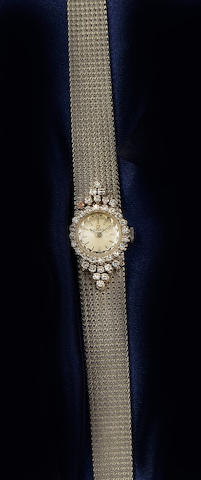 Omega: A lady's diamond set wristwatch