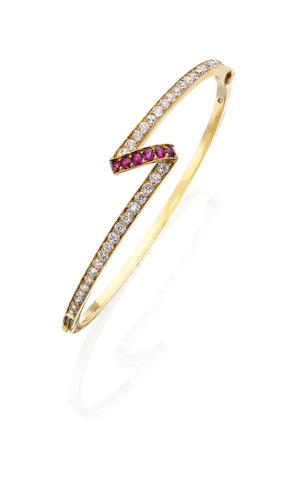 A late 19th century ruby and diamond bangle